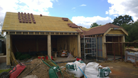 Oak cladding and roof tiles fitted