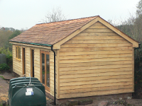 Oak cladding and cedar shingles fitted
